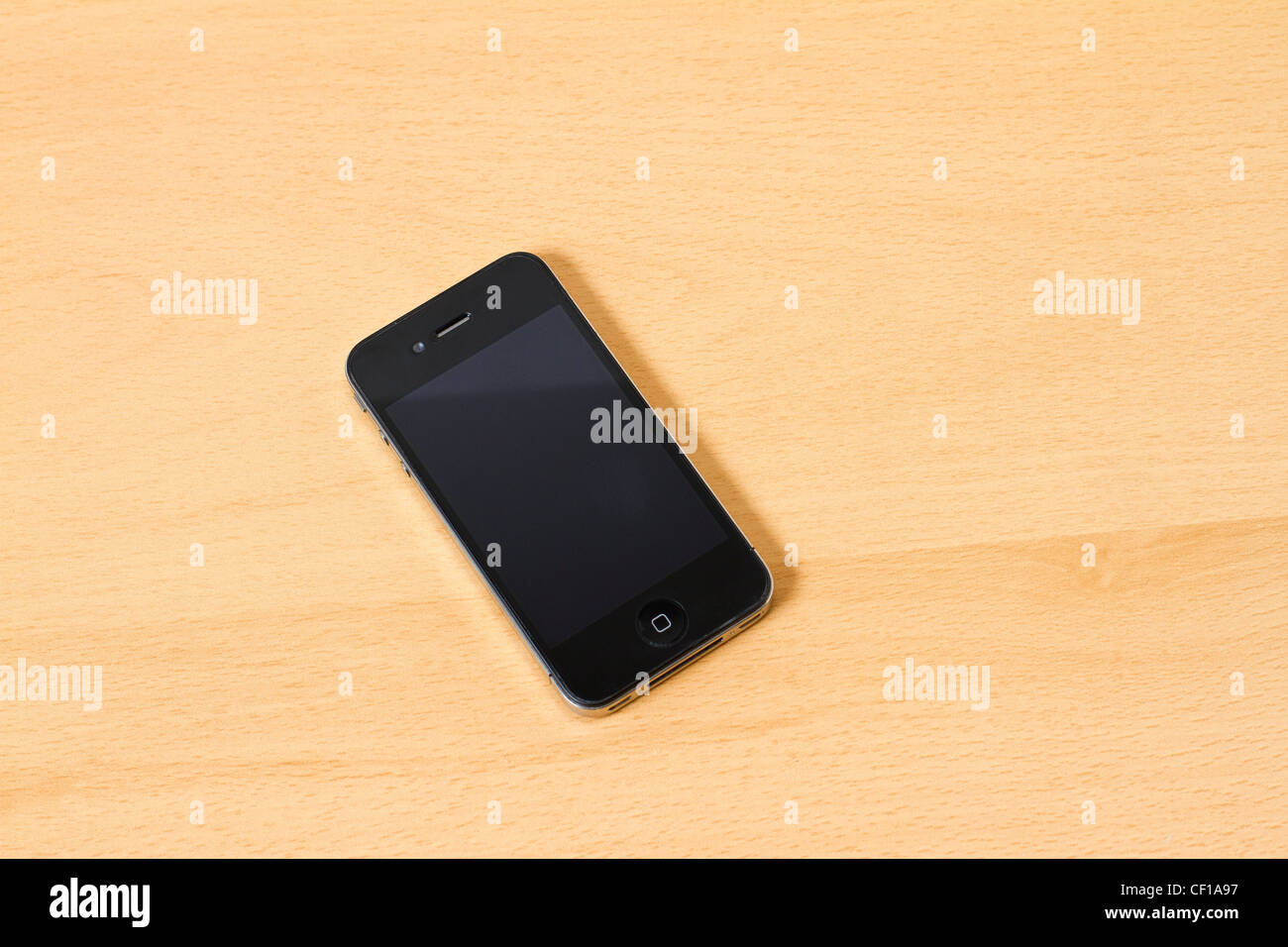 Turned Off Apple Iphone4 4s On A Wooden Table Background Stock Photo