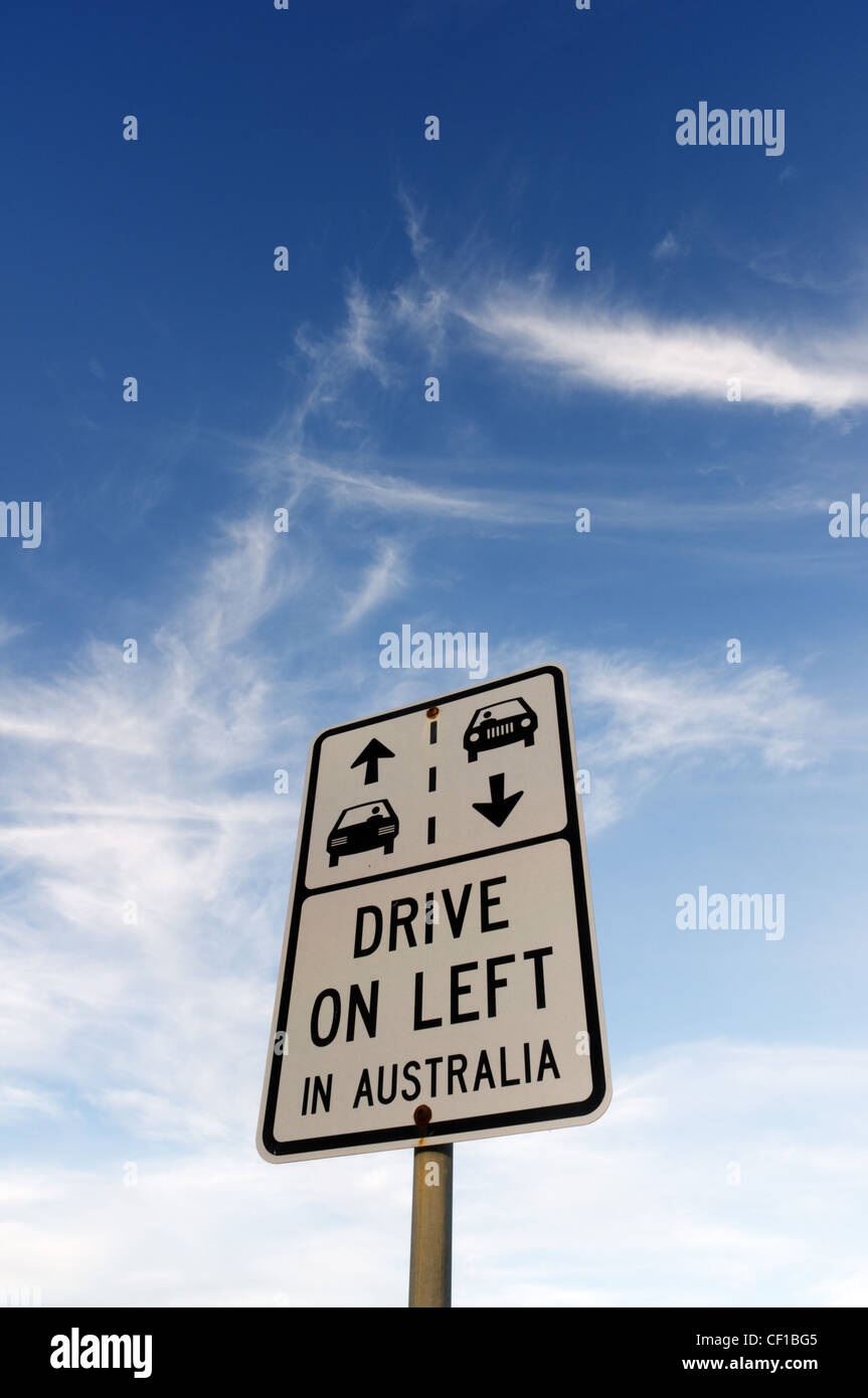 A road sign in Australia that reads 'Drive on left in Australia' - Stock Image