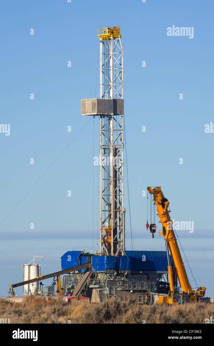 drill rig set up for winter drilling in Wyoming - Stock Image