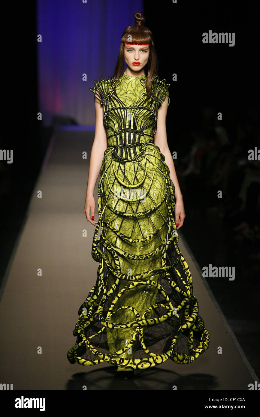 52f04d6c3f7 Jean Paul Gaultier Paris Haute Couture Autumn Winter Model wearing lime  green patterned ankle length dress, a black and green