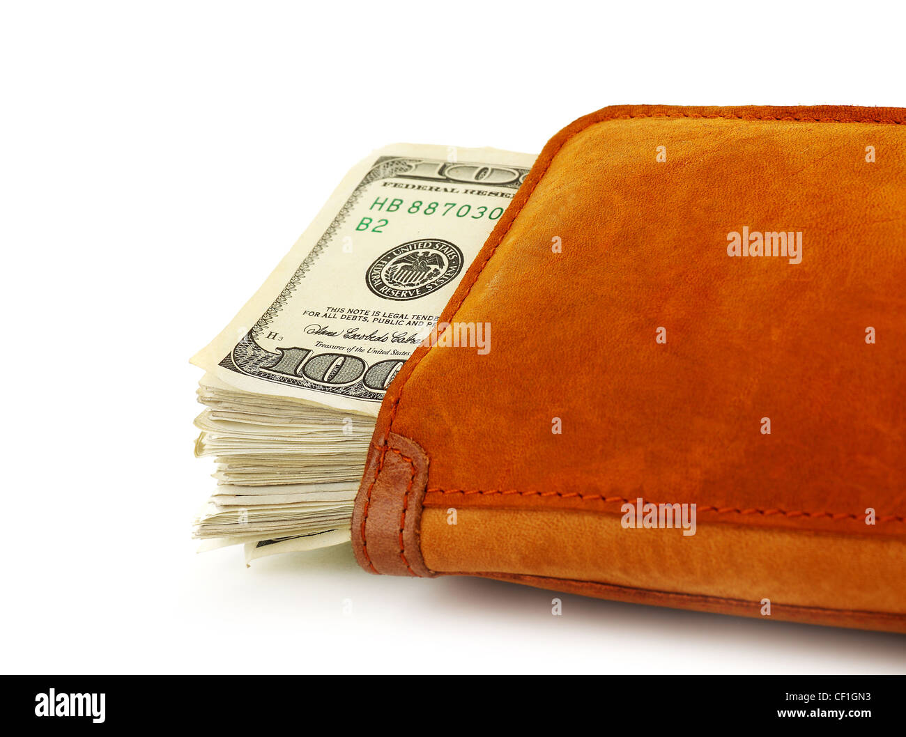 Hundred dollar banknotes in a purse isolated on white, conceptual image of saving, making & spending cash money - Stock Image