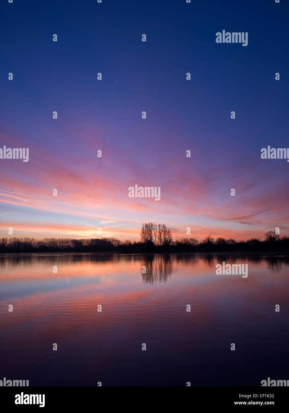 Dawn over Mallard Lake at Lower More Farm. The lake is designated as a Site of Special Scientific Interest as it - Stock Image
