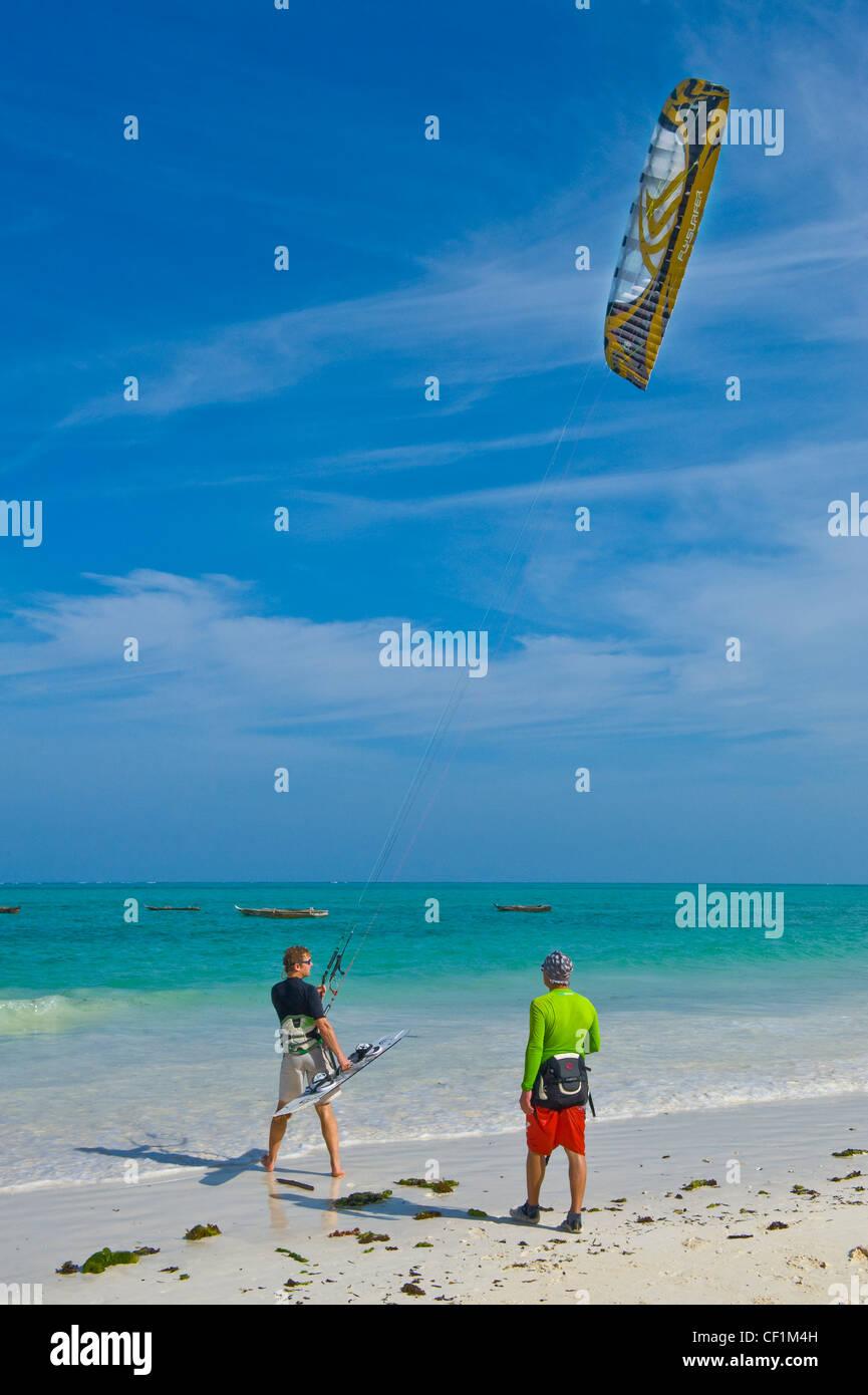Kite surfer beginner with trainer, Paje, Zanzibar, Tanzania - Stock Image