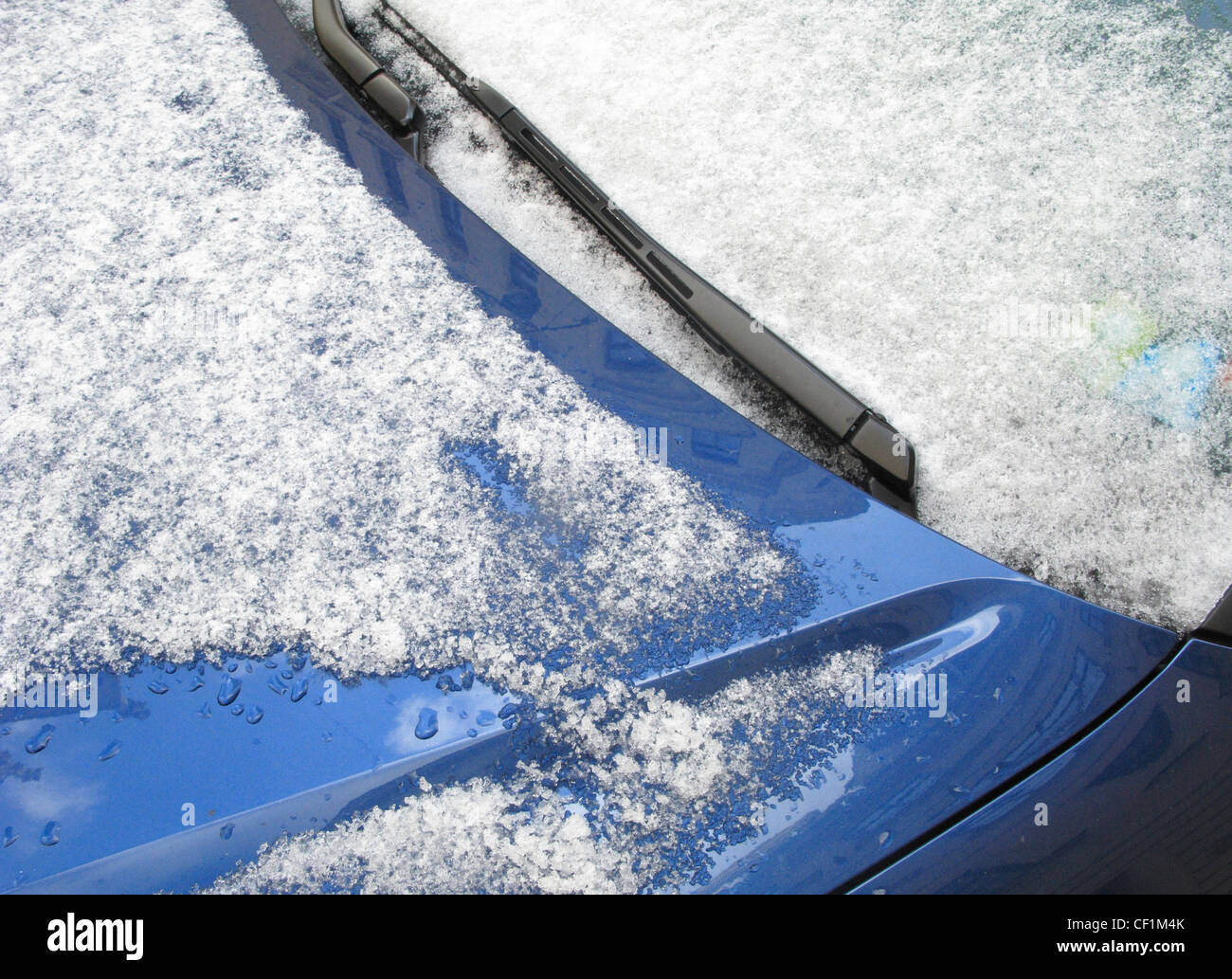 Close-up of windshield covered with ice and snow - Stock Image