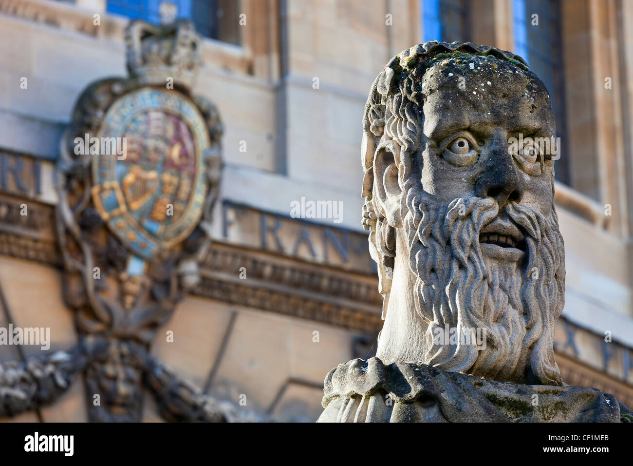 The head of an 'Emperor', one of thirteen busts on top of pillars marking the front boundary of the Sheldonian Theatre, Stock Photo