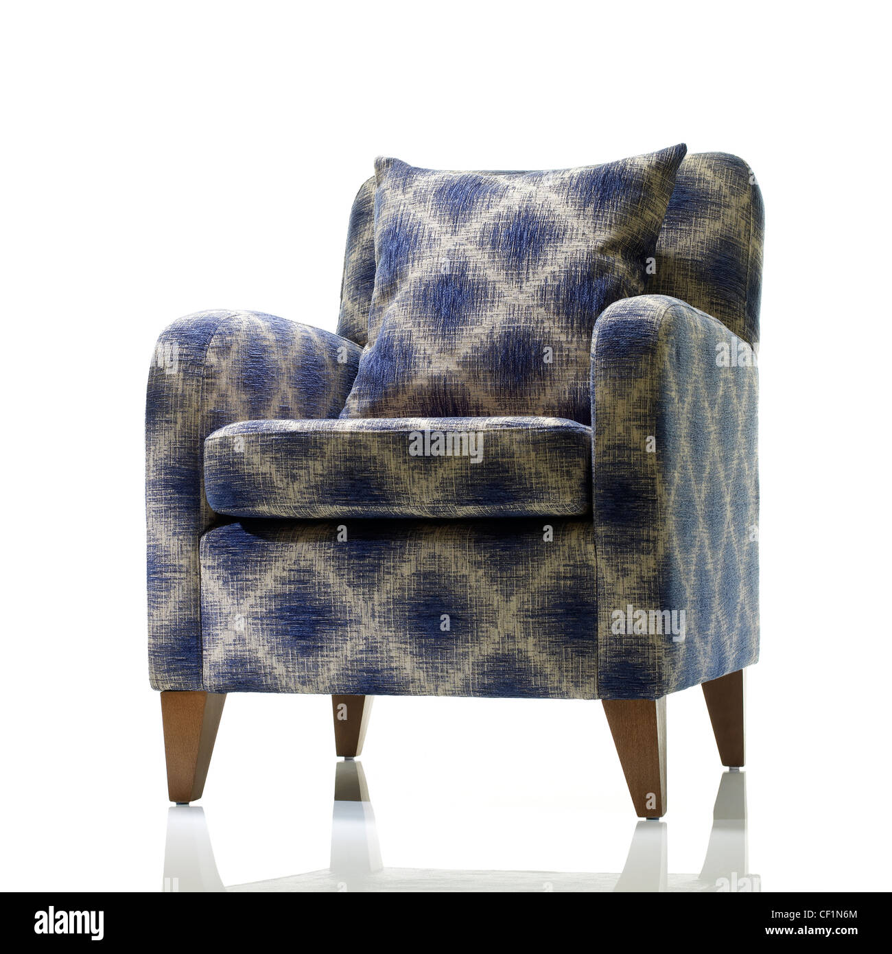 A still life shot of a a stylish blue and white armchair - Stock Image