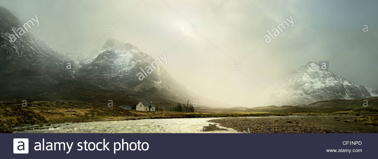 Cottage by the River Coe flowing through Glen Coe, one of the most beautiful locations in Scotland. - Stock Image
