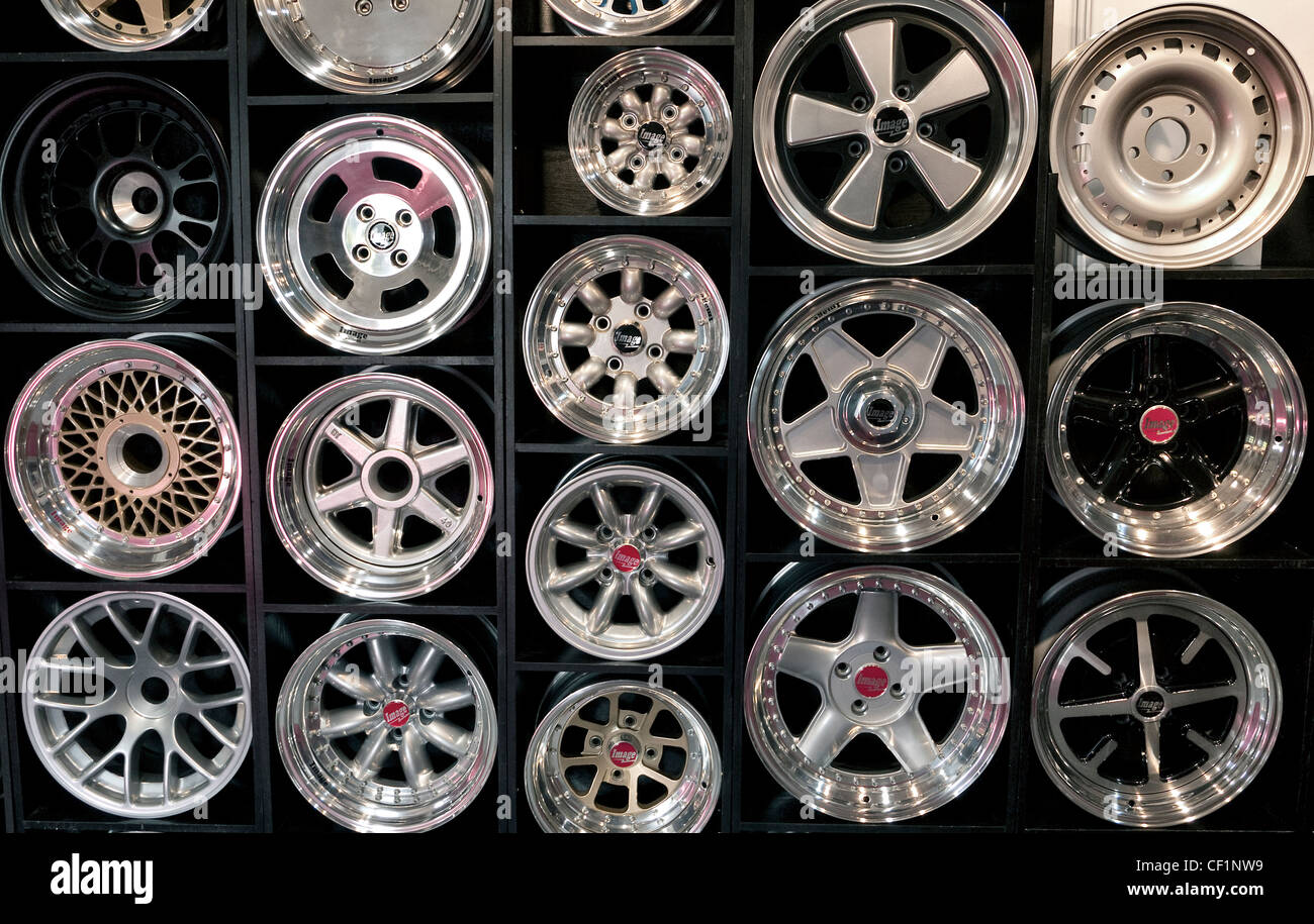 Automobile wheels on display at a dealership - Stock Image
