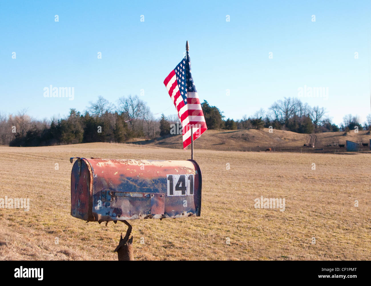 roadside rural mailbox with American flag - Stock Image