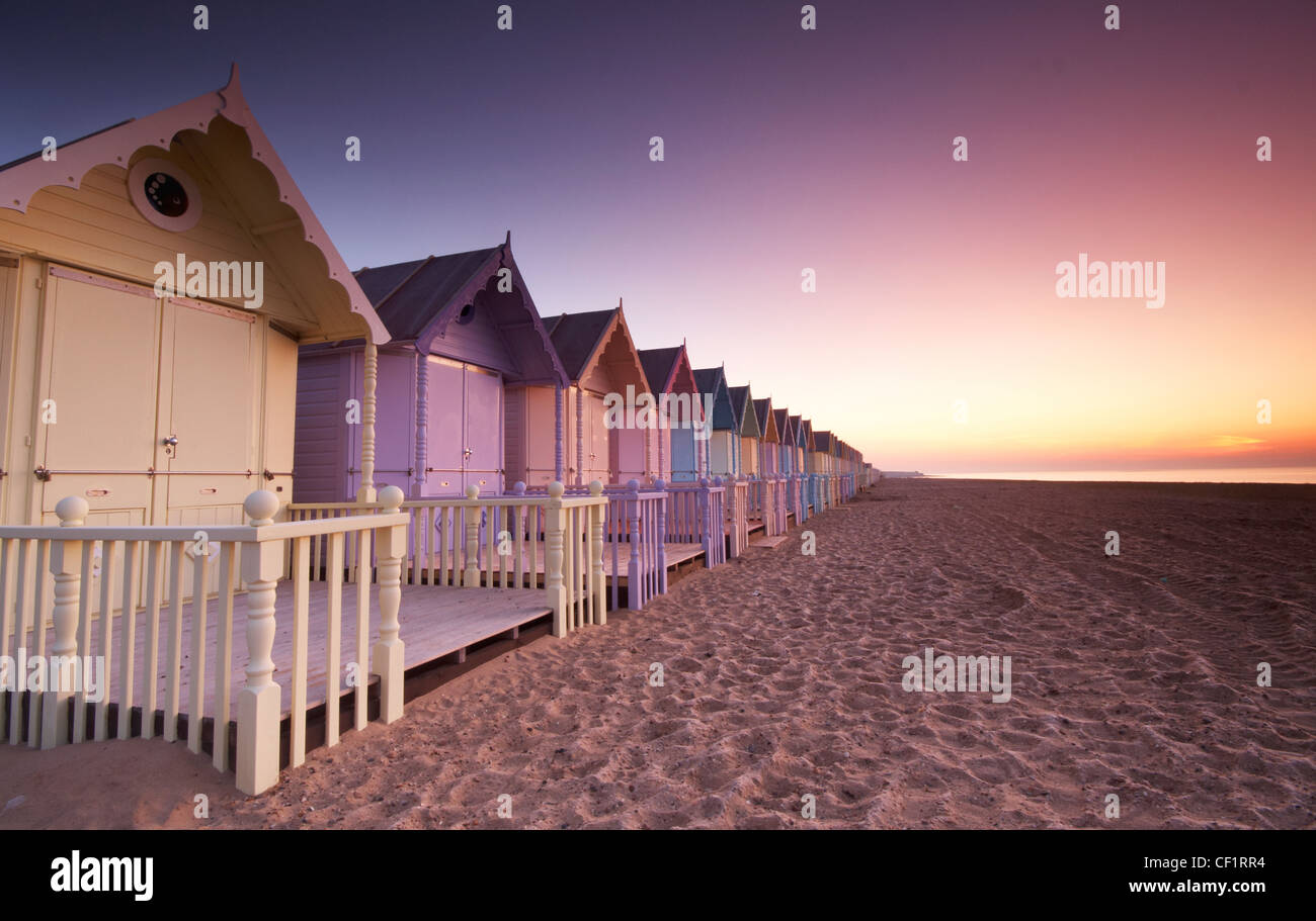 Early dawn over new beach huts on Mersea Island. Stock Photo