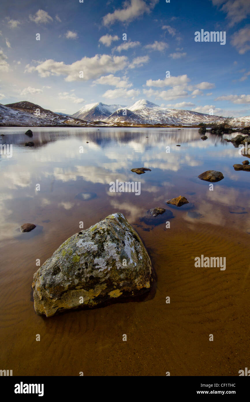 Still calm waters on Rannoch Moor, a 50 square mile plateau surrounded by mountains. - Stock Image