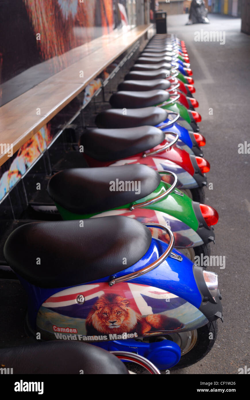 Novelty stools shaped like scooters in Camden market. - Stock Image