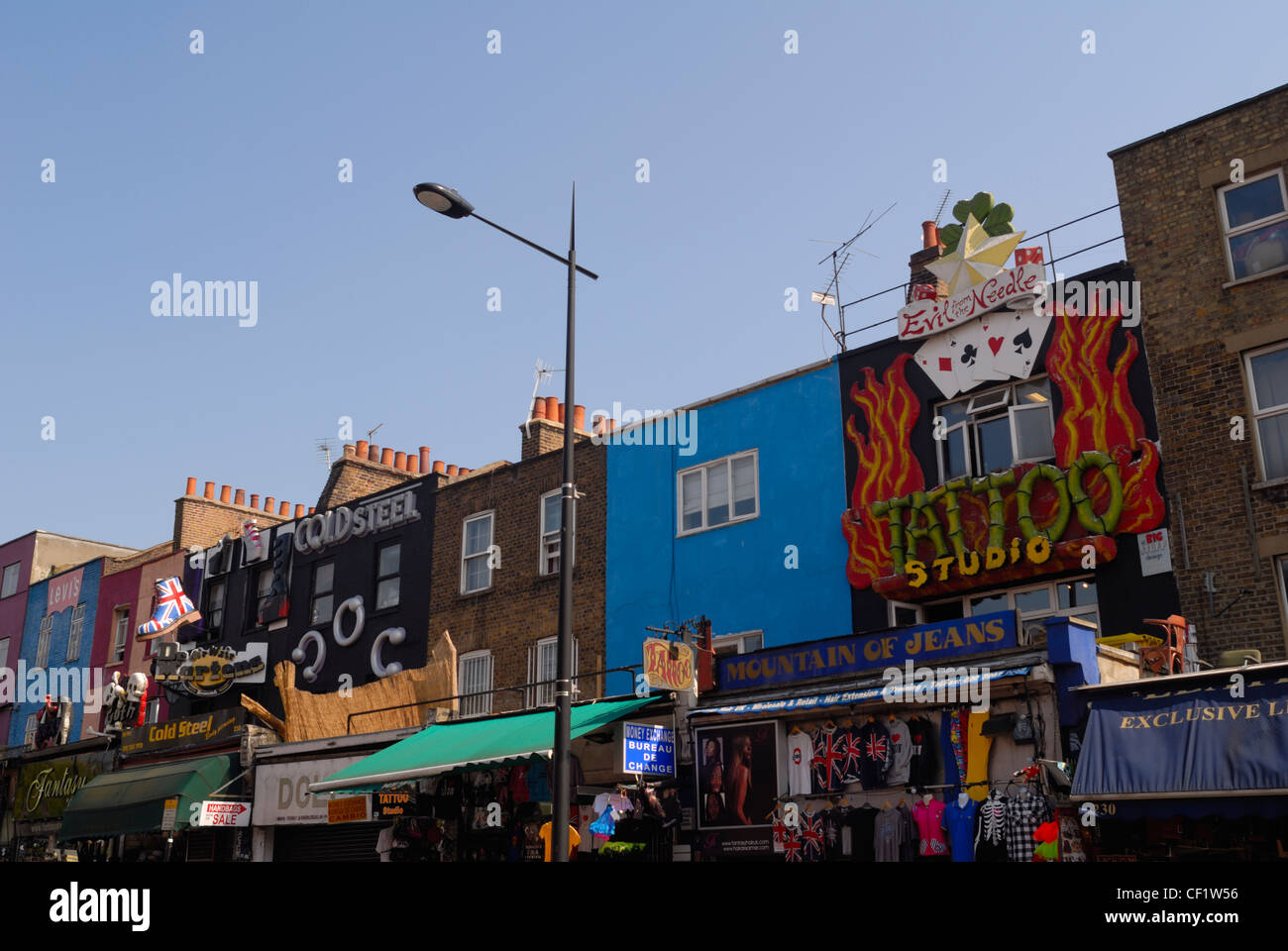 Colourful and elaborate shopfronts compete to get shoppers attention in Camden High Street near the market. - Stock Image