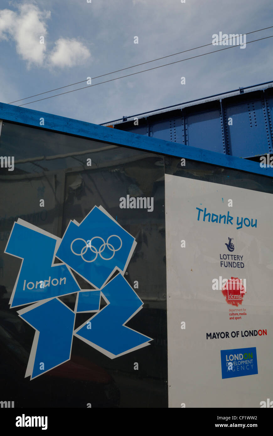 The London 2012 Olympic logo displayed on hoardings outside the entrance of the construction site for the Olympic - Stock Image