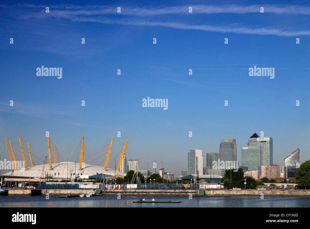 The O2 (formerly known as the Millennium Dome) on the Greenwich peninsula in South East London and the Canary Wharf - Stock Image
