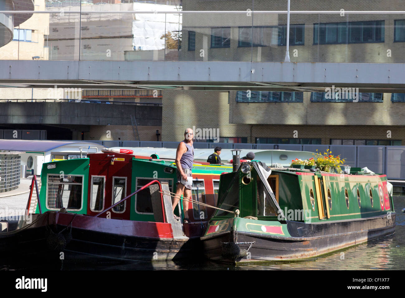 Narrowboats moored in the Paddington Arm of the Grand Union Canal - Stock Image