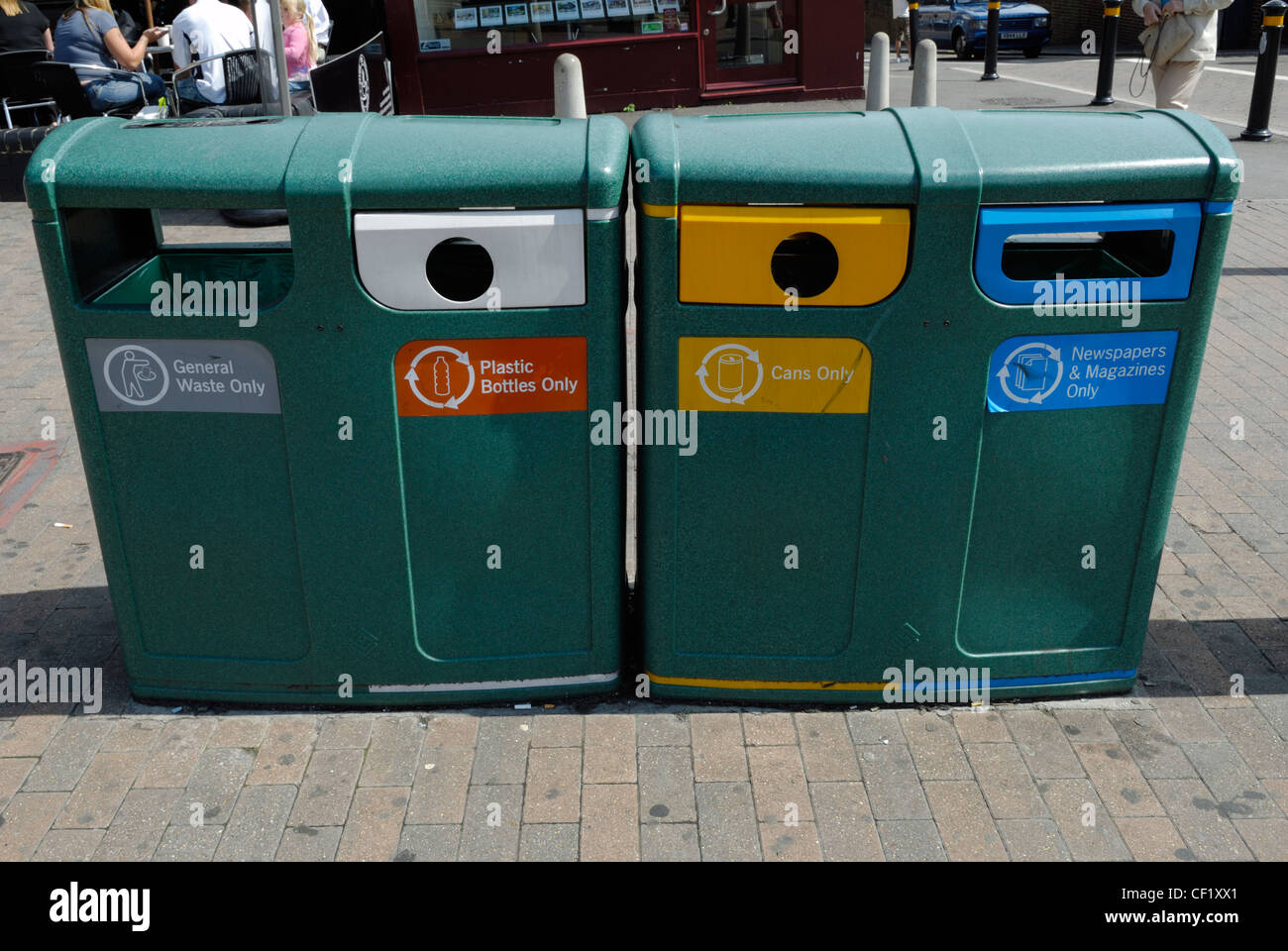Waste bins for the collection of general  and recyclable waste outside Bromley South railway station. - Stock Image