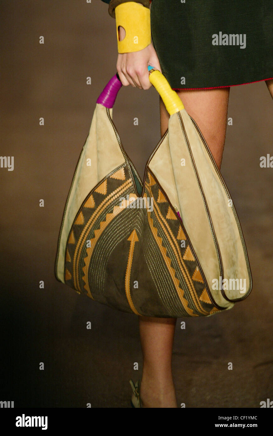 e287ebdac5a Costume National Paris Spring Summer Close up of models hand yellow cuff  holding purple and yellow leather wrapped around