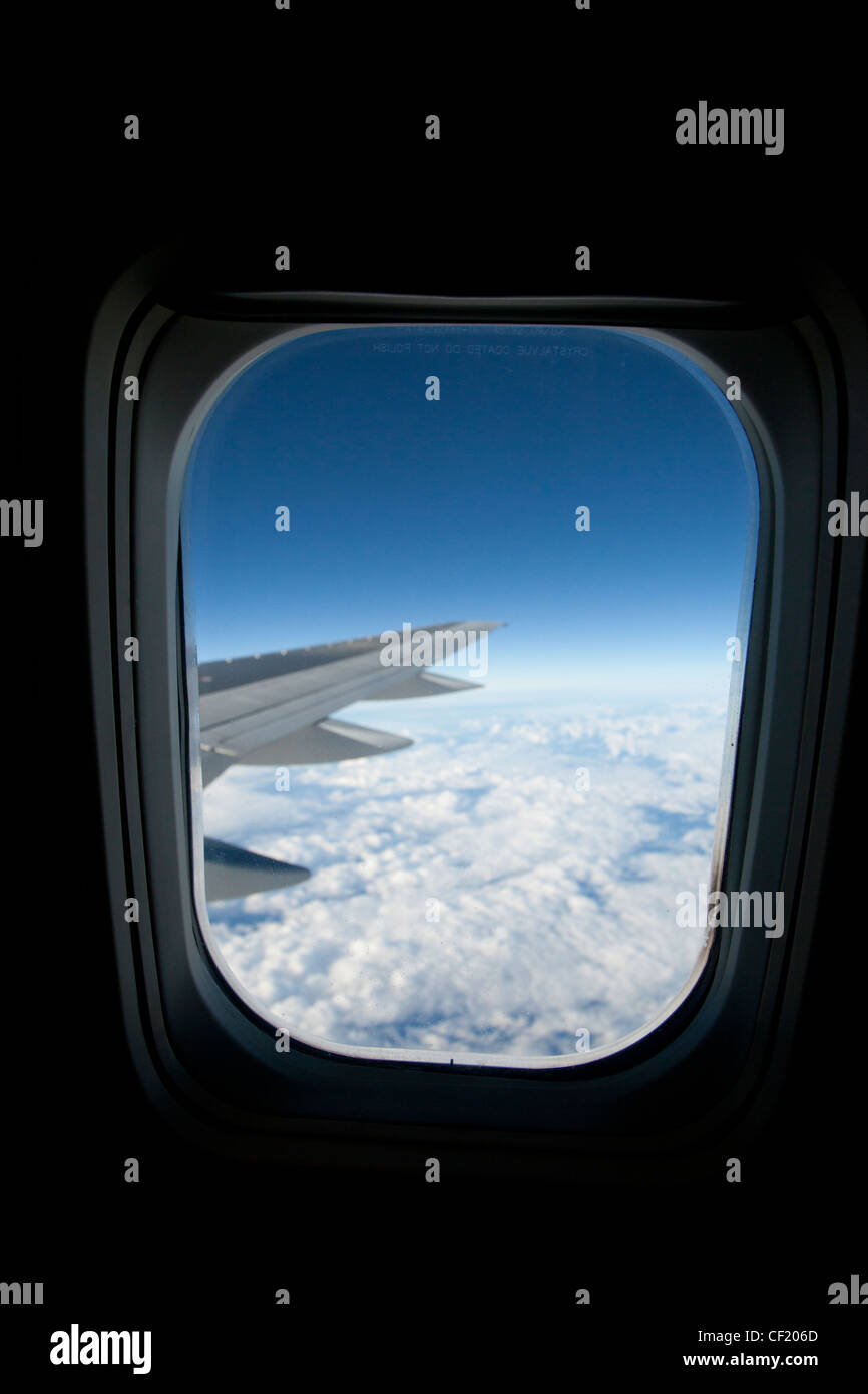 A view from the window of a aeroplane at altitude Stock Photo
