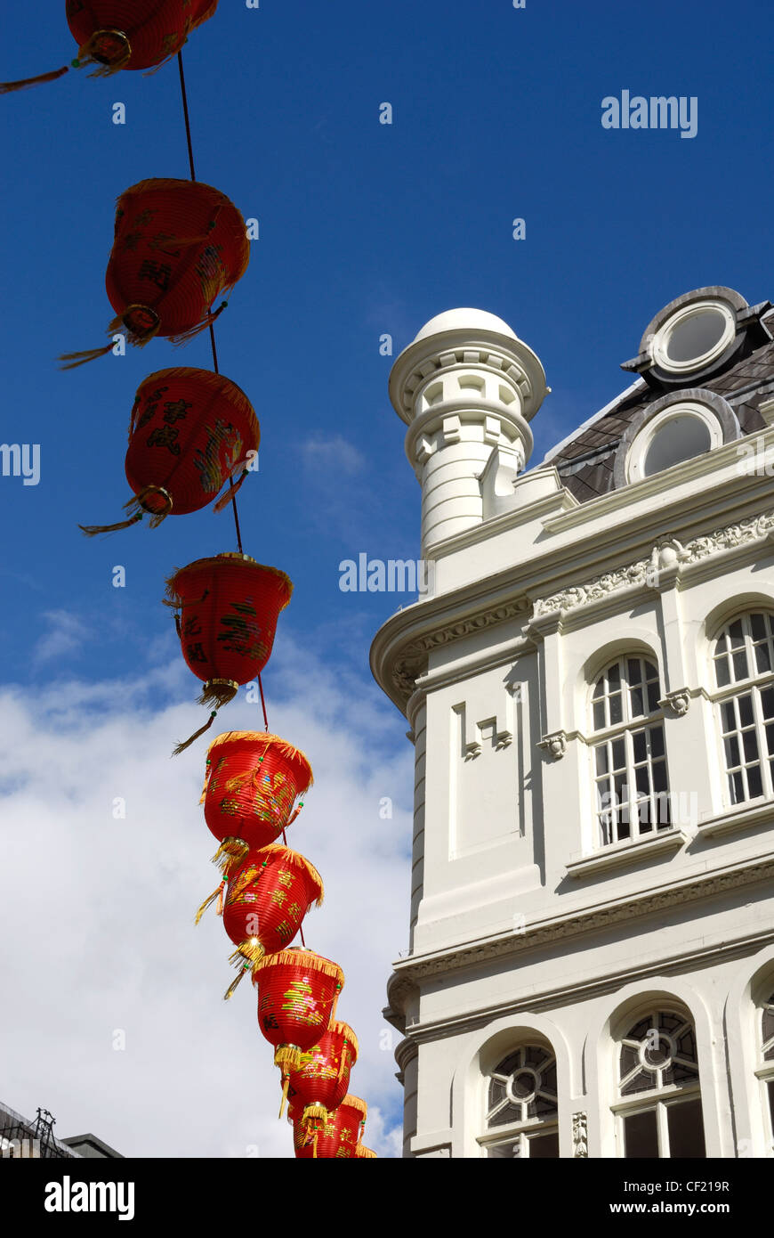Lanterns hanging above the street in London's Chinatown. - Stock Image