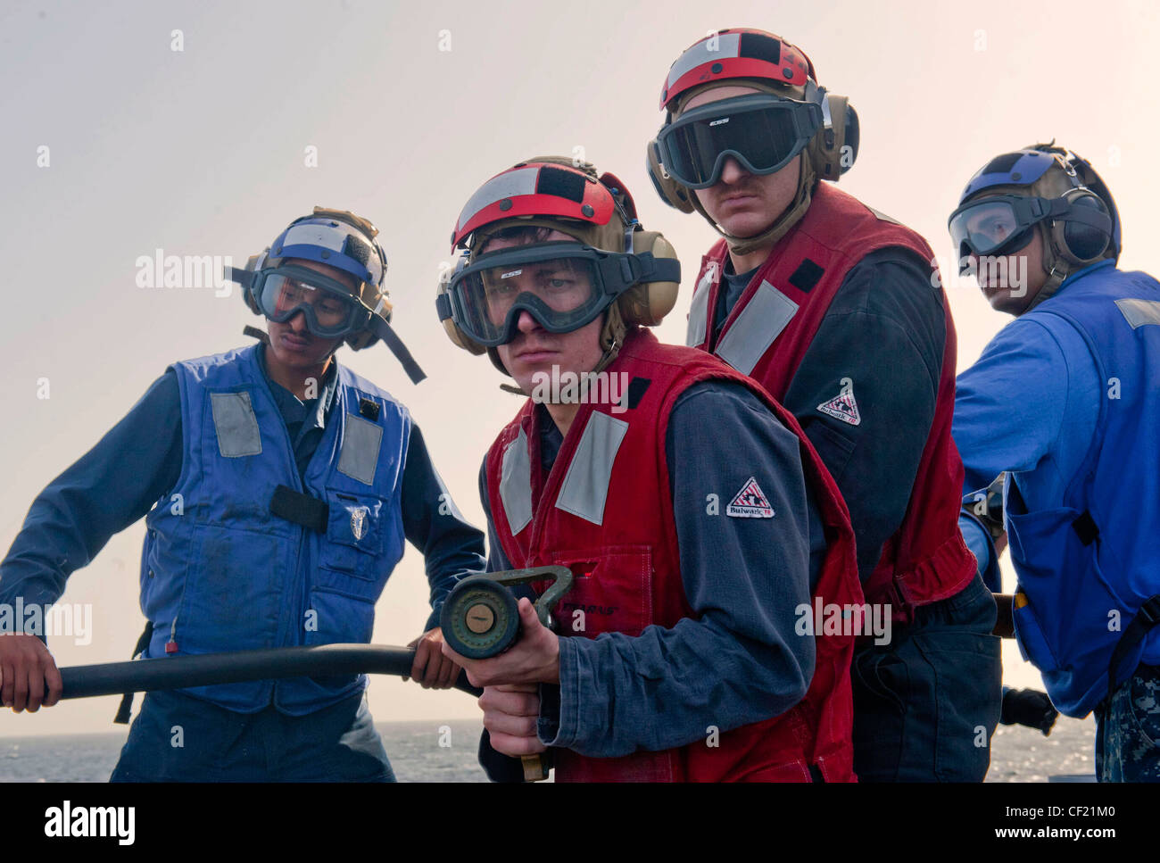 ARABIAN SEA (Feb. 21, 2012) Damage Controlman Fireman Keith Modisette and Damage Controlman 3rd Class Nicholas Fisher - Stock Image