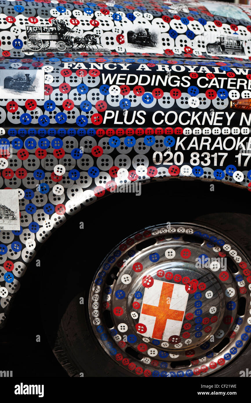 Pearly Kings and Queens decorated London taxi cab. - Stock Image