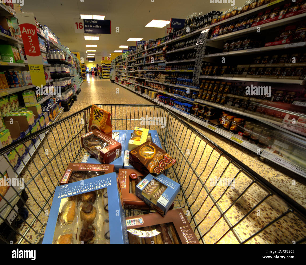 A trolley of birthday cakes in a UK Tesco store Stock Photo