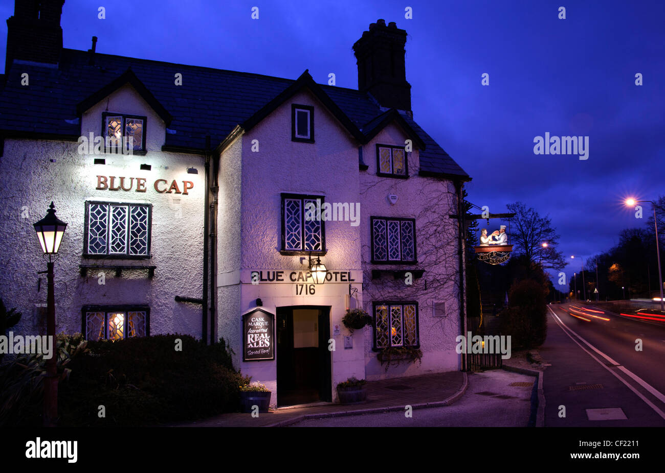 Blue Cap historic Pub and drinking place A556 at Dusk , Cheshire , England, United Kingdom Stock Photo