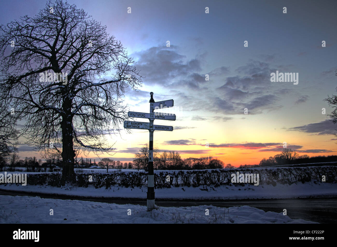 Budworth / Antrobus Sunset And Fingerpost Stock Photo