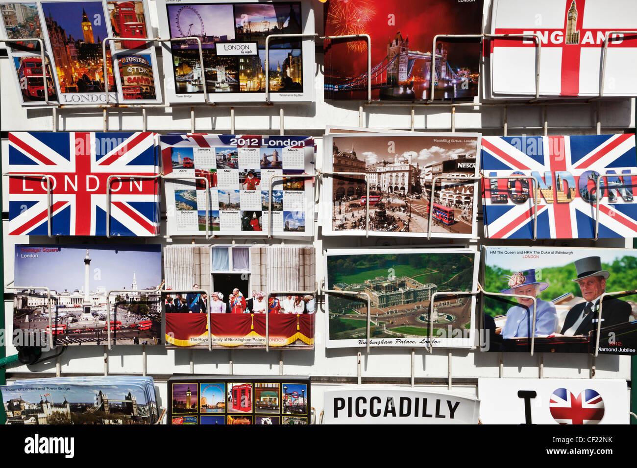 Souvenir postcards of London on display in a rack. - Stock Image