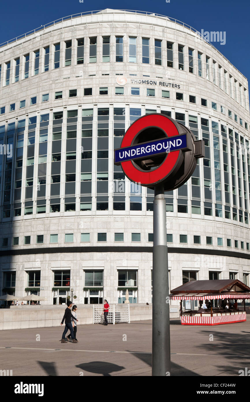 London Underground sign in Canary Wharf opposite the Thomson Reuters building. - Stock Image