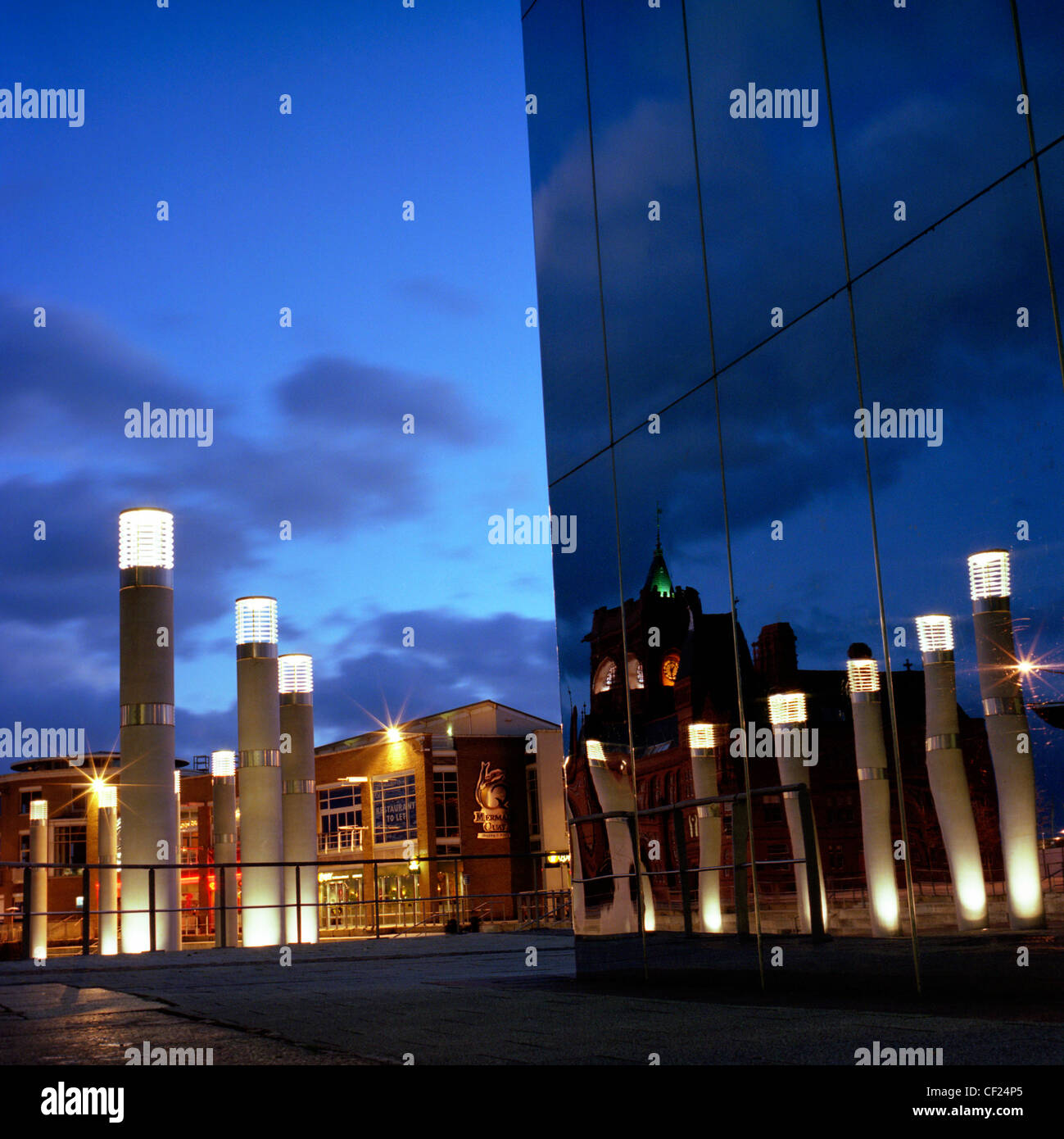The mirrored tower in front of the Wales Millennium Centre with lights reflected. Opened in 2004, it is a centre - Stock Image