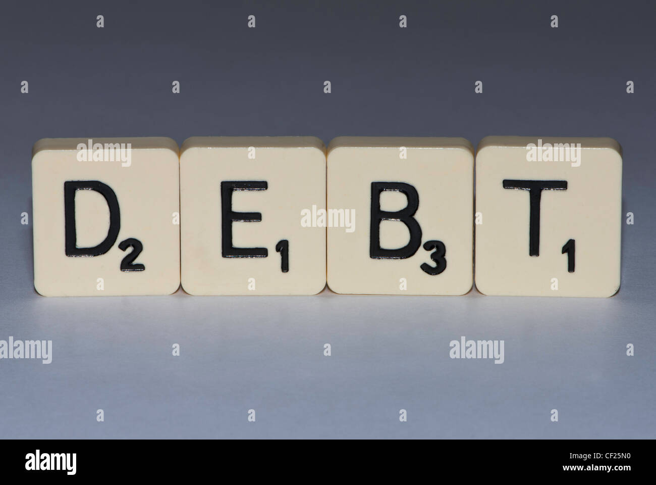 Letters spelling the word debt - Stock Image