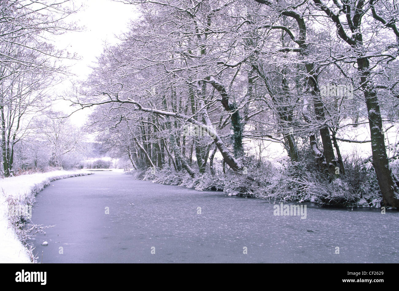 The Staffordshire Worcestshire Canal shortly after a winter snowfall. - Stock Image