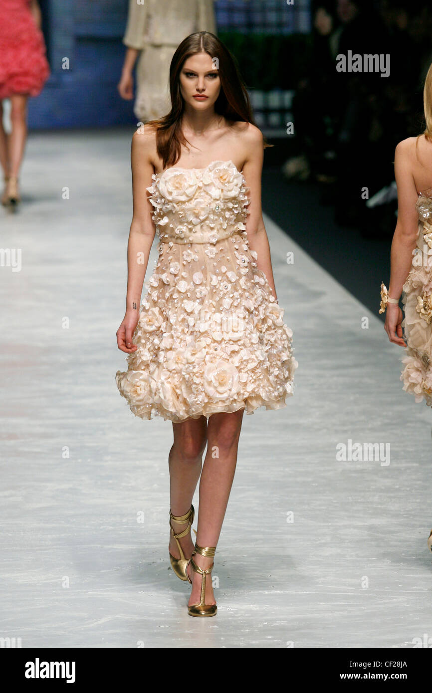 peach dress with gold shoes