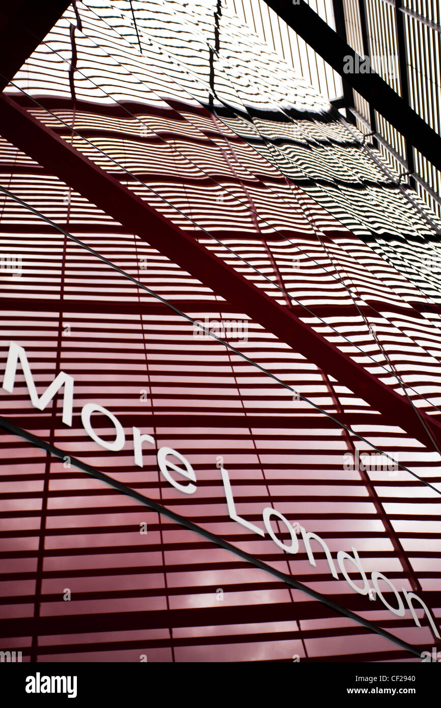 'More London' wording displayed on '6 More London Place', an office and retail development by the - Stock Image