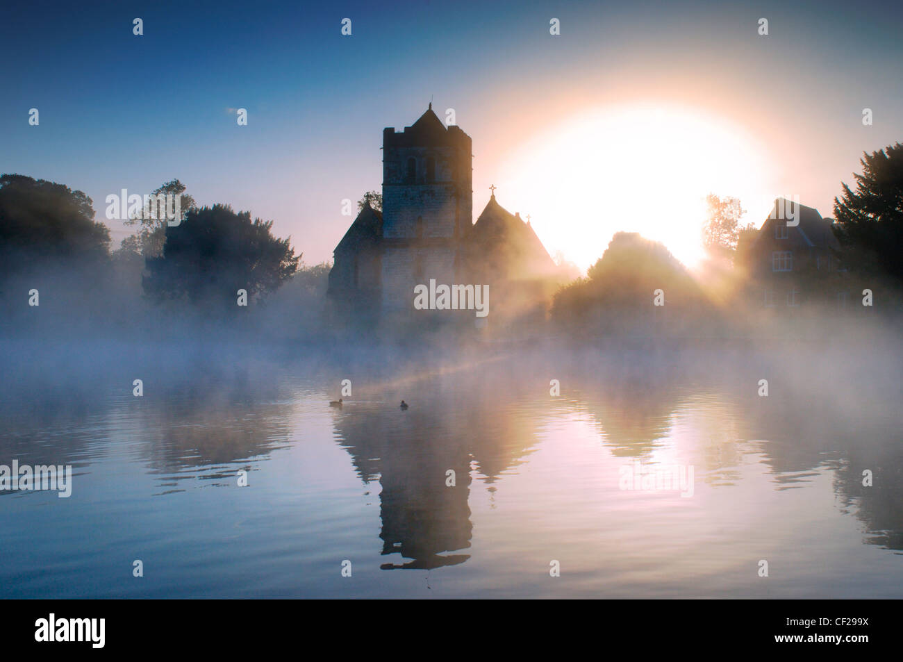 Bisham Church in the early morning mist with ducks. Bisham is home to one of the Sport England's National Sports - Stock Image