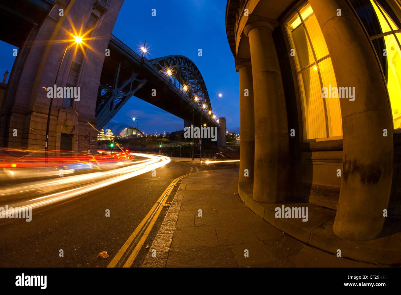 Rush hour traffic near the Tyne Bridge and the Guildhall. Stock Photo