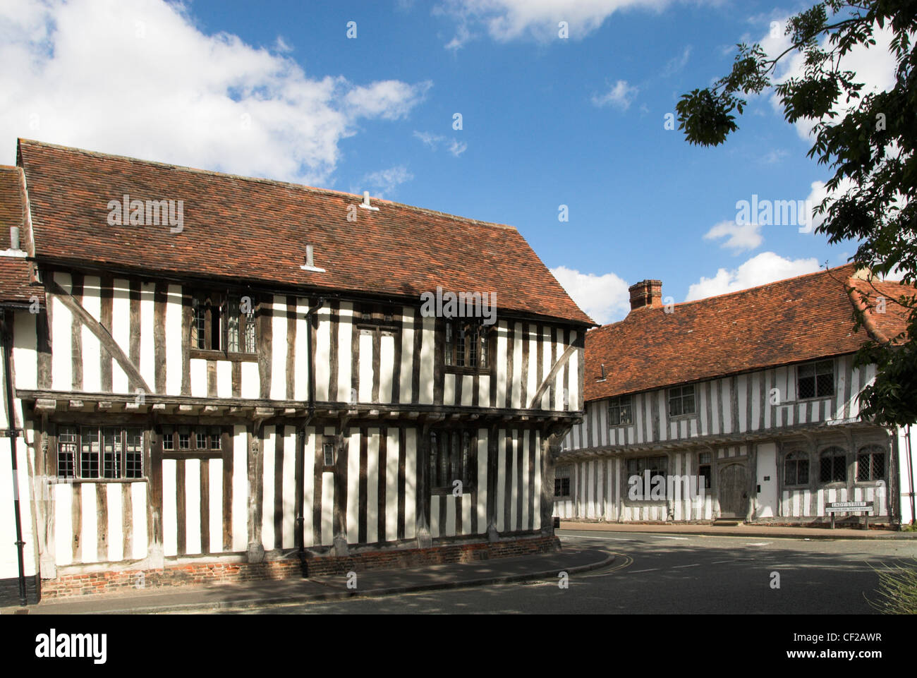 Half-timbered medieval houses in the village of Lavenham. - Stock Image