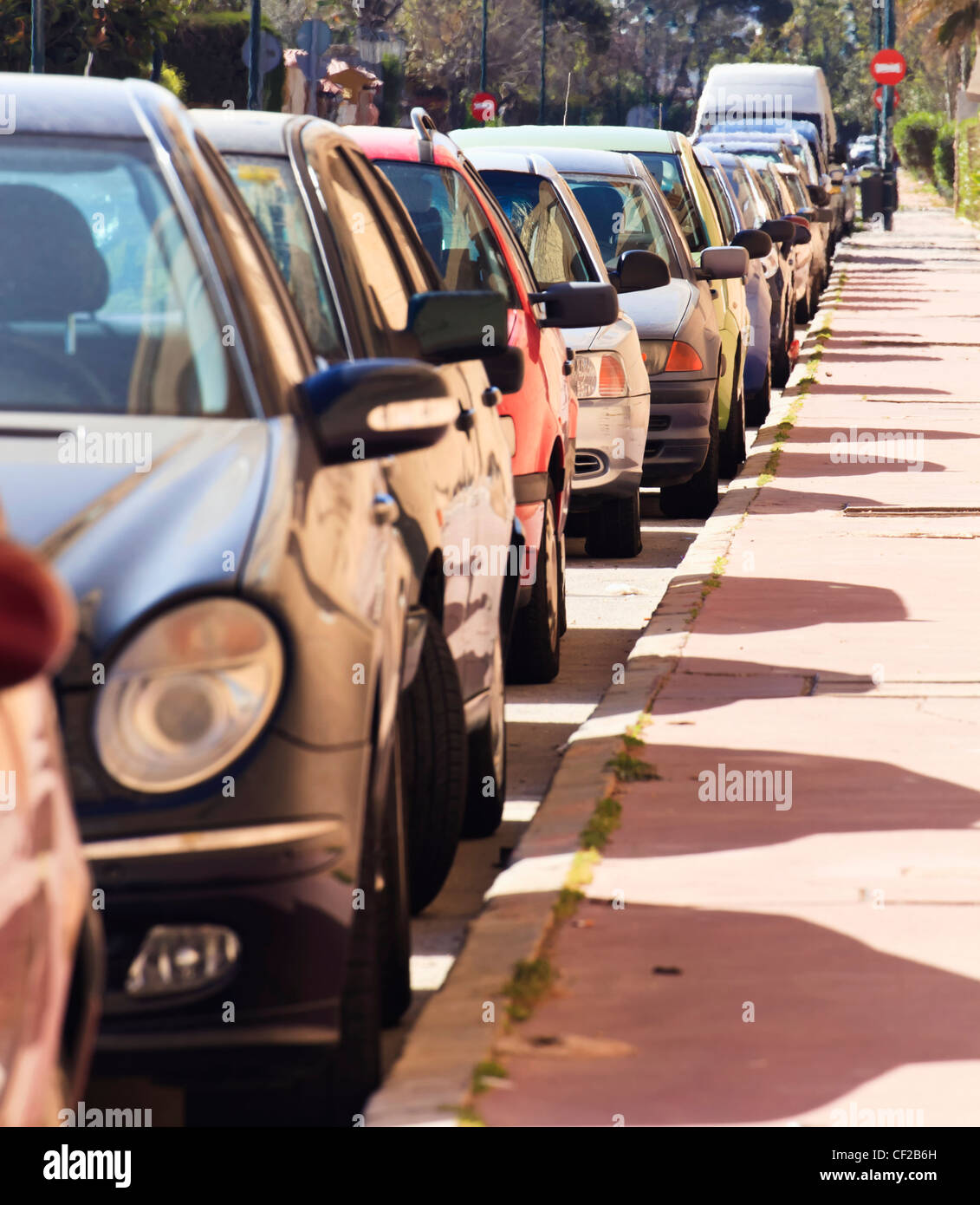 Cars Parked In Line On Street; Malaga Spain - Stock Image