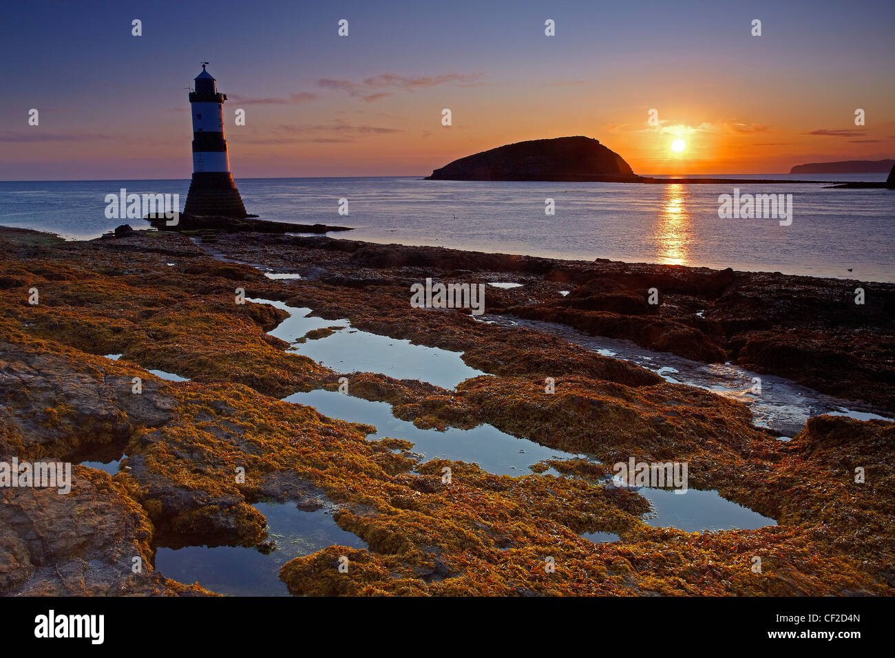 Penmon Lighthouse, also known as Menai Lighthouse, at the north entrance to the Menai Strait opposite Puffin Island - Stock Image