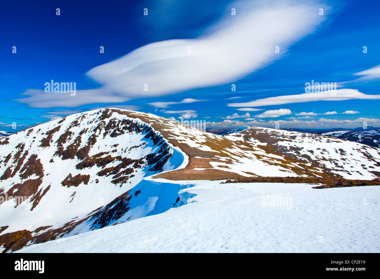 Looking towards the snow covered Cairn Toul, the fourth highest mountain in Scotland, with the southern peaks of - Stock Image
