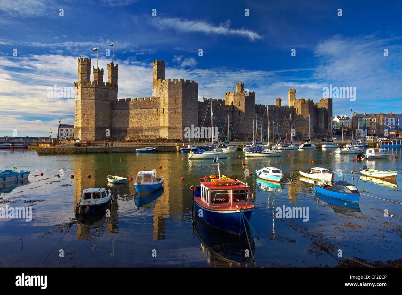 Boats moored by Caernarfon Castle at the mouth of the of the Seiont river. Stock Photo