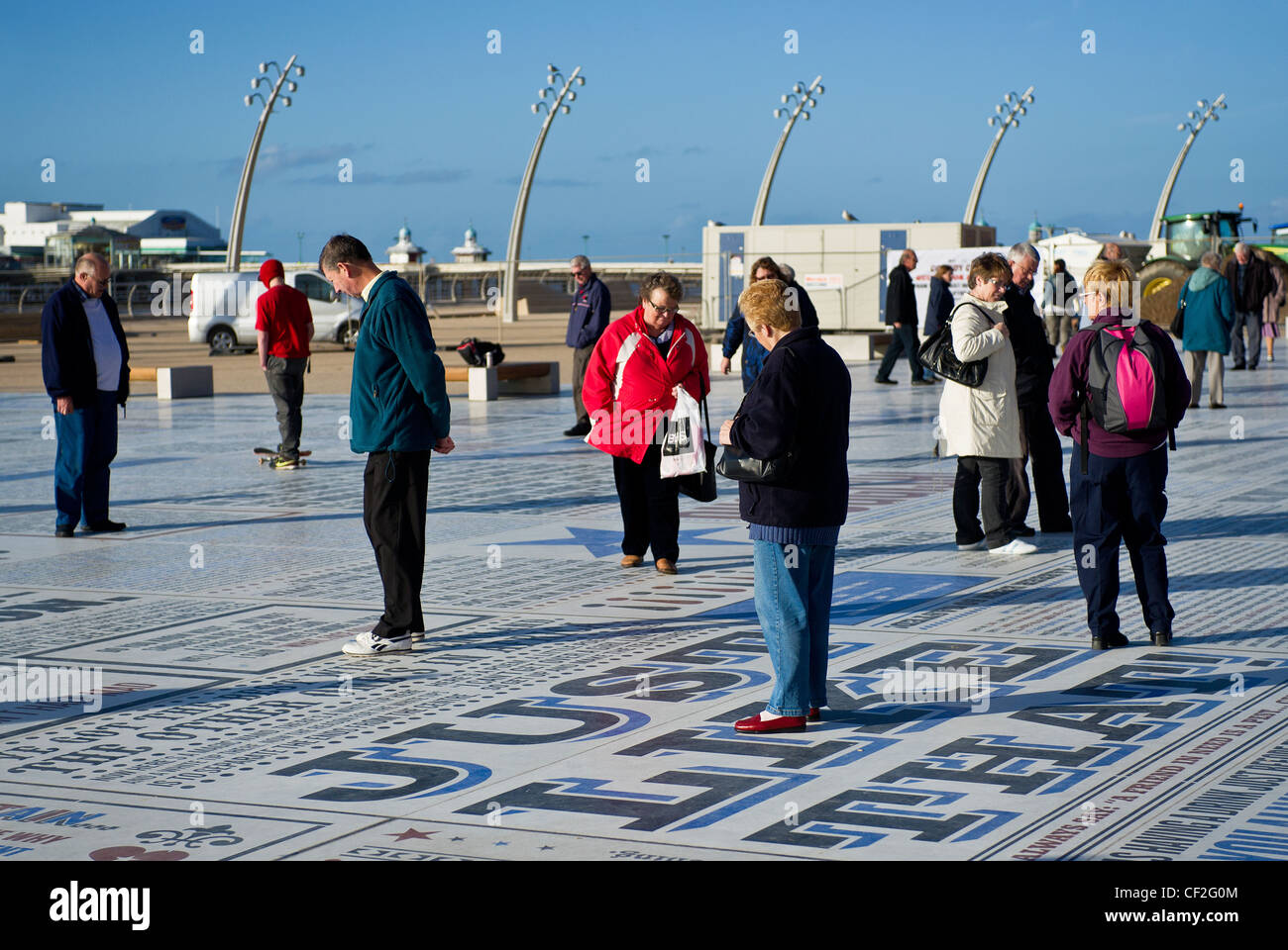 People standing on the Comedy carpet, one of the largest pieces of public art ever commissioned in the UK, on Blackpool - Stock Image