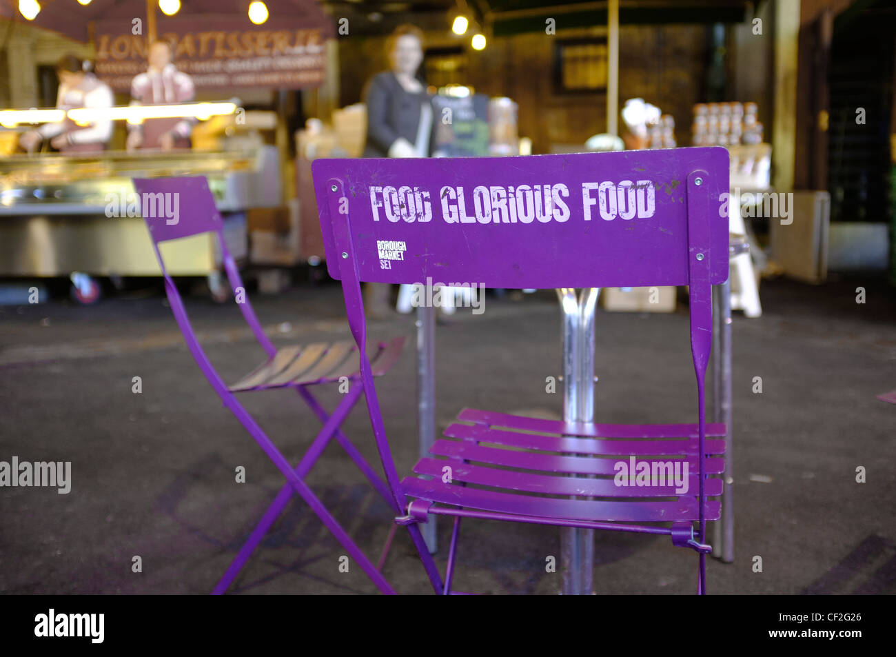 Food Glorious Food written on the back of a chair by a cafe table at Borough Market. - Stock Image