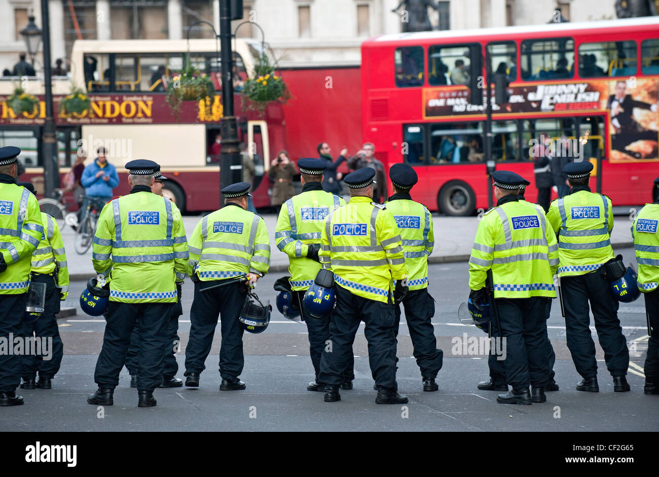 A cordon of Metropolitan Police Officers on duty in central London. - Stock Image