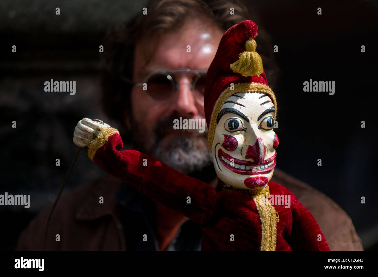 Mr Punch and a puppeteer at the annual Punch and Judy festival held in Covent Garden. - Stock Image