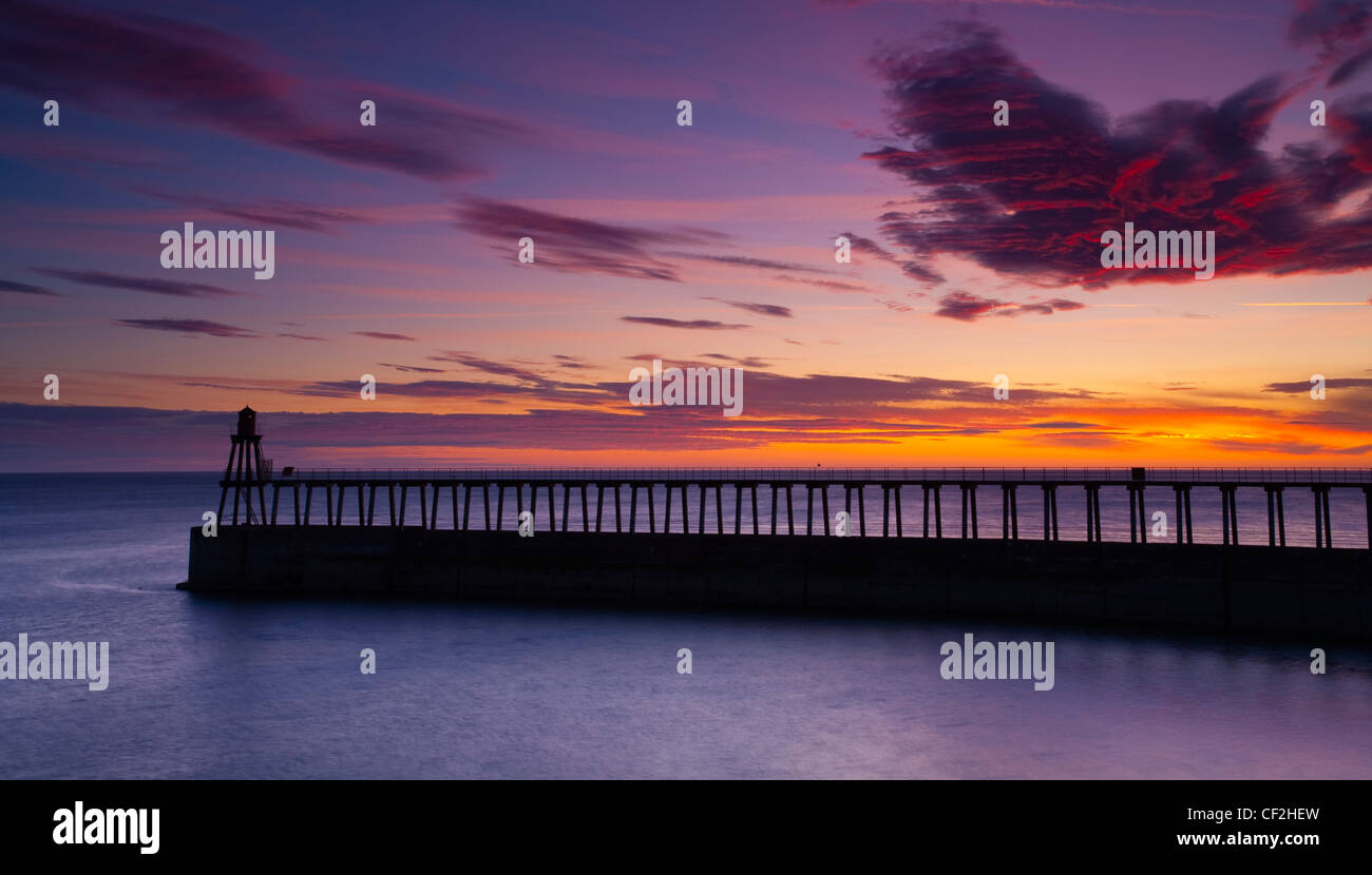 One of the entrance piers of Whitby Harbour at dawn. - Stock Image