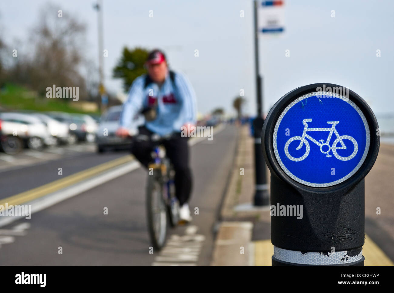 A sign indicating a cycle lane on the seafront at Southend-on-Sea. - Stock Image