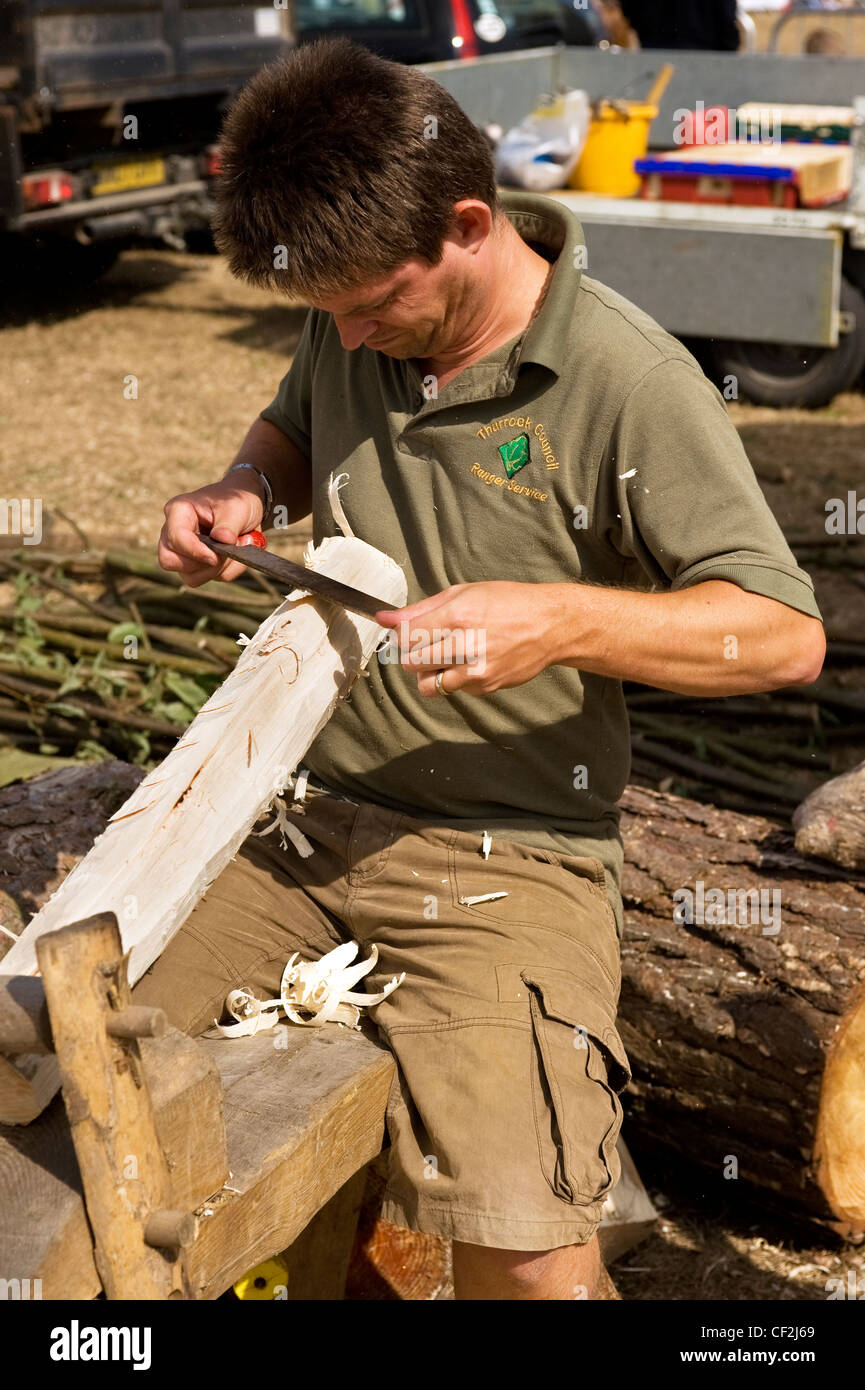 A man from the Thurrock Council Ranger Service demonstrating traditional woodworking techniques at the Orsett Show, Stock Photo